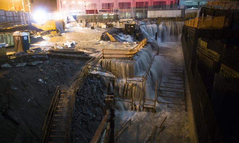 Sea water floods the Ground Zero construction site in New York City on Monday. (John Minchillo/AP)