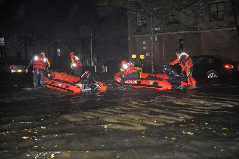 FDNY inflatable boats travel along 14th street towards the East River on a rescue mission in the wake of Hurricane Sandy on Monday. (Louis Lanzano/AP)