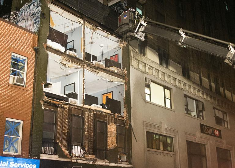 The facade of a four-story building on 14th Street and 8th Avenue collapsed onto the sidewalk on Monday in New York. (John Minchillo/AP)