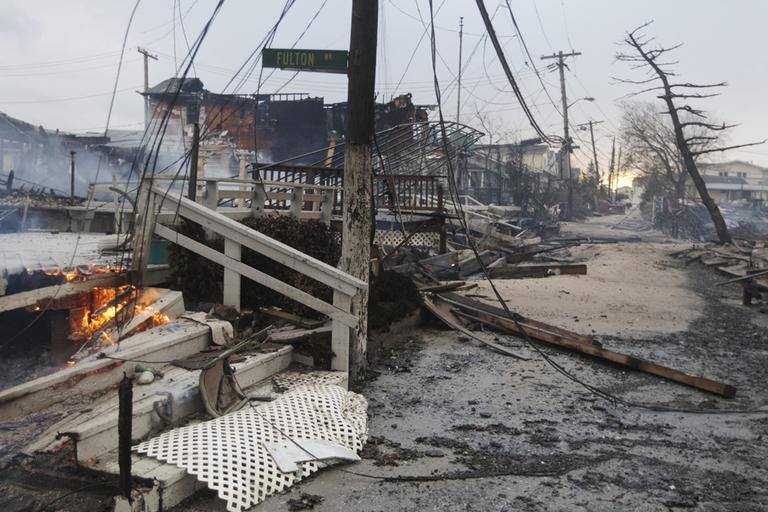 Damage caused by a fire at Breezy Point is shown on Tuesday in the New York City borough of Queens. The fire destroyed between 80 and 100 houses Monday night in the flooded neighborhood. (Frank Franklin II/AP)