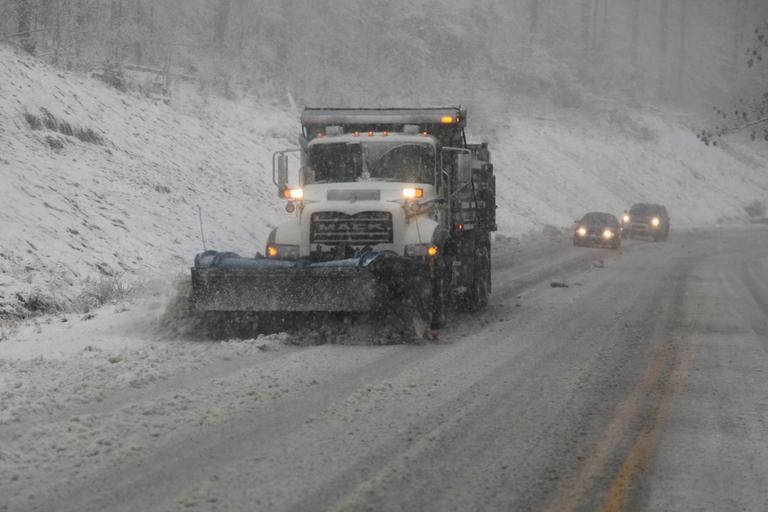 Snow plows thunder through the mountains of West Virginia as the superstorm begins it's raking of the region on Monday evening. (Robert Ray/AP)