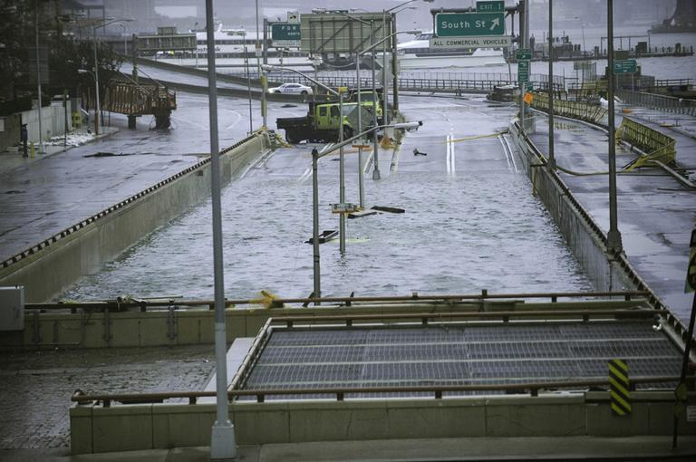 Water reaches the street level of the flooded Battery Park Underpass on Tuesday. (Louis Lanzano/AP)