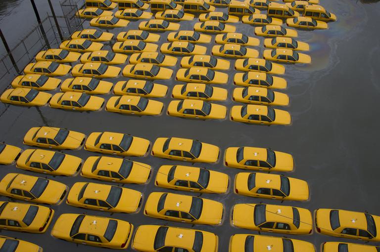 A parking lot full of yellow cabs in Hoboken, N.J., is flooded on Tuesday, as a result of Hurricane Sandy. (Charles Sykes/AP)