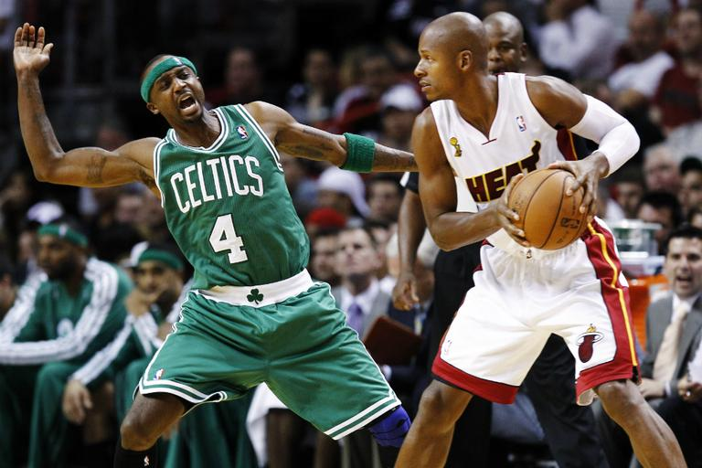 Boston Celtics' Jason Terry tries to block Miami Heat's Ray Allen, formerly of the Celtics, on Tuesday in Miami. (J Pat Carter/AP)