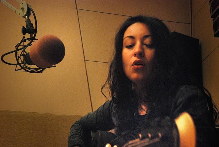Mieka Pauley rehearsing in the WBUR studios. (Jesse Costa/WBUR)