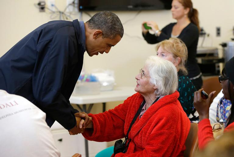 President Obama meets with a local resident at the Brigantine Beach Community Center in Brigantine, N.J., Wednesday. Obama traveled to the Atlantic Coast to see firsthand the relief efforts after Superstorm Sandy. (Pablo Martinez Monsivais/AP)