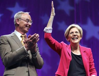 Bruce Mann accompanied his wife, Elizabeth Warren, at the Democratic State Convention in Springfield on June 2. (Michael Dwyer/AP)
