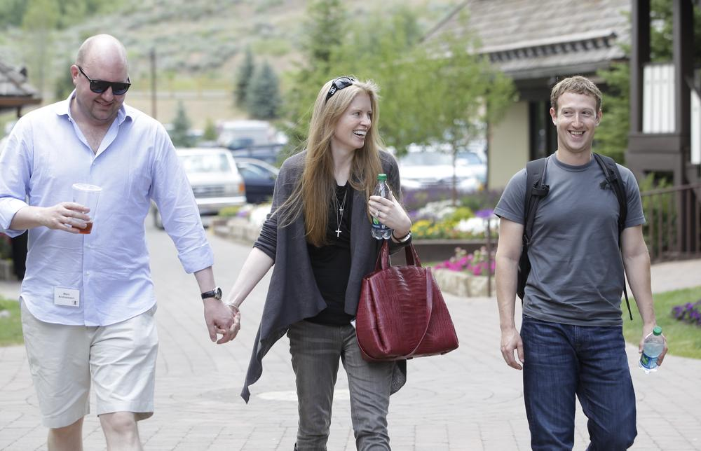 Facebook CEO Mark Zuckerberg, right, walks with Laura Arrillaga-Andressen, center, wife of Marc Andressen, left, at the Allen & Company Sun Valley Conference in Sun Valley, Idaho, Wednesday, July 11, 2012. Marc Andreessen is founder of Netscape. (AP)