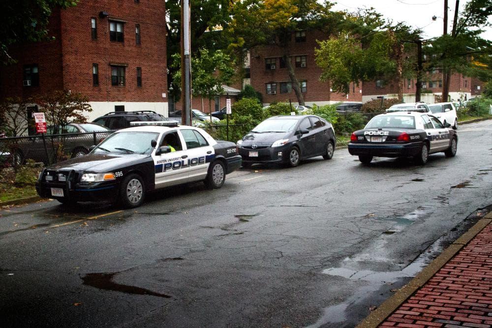 Boston University police cars patrol near the campus' Boston/Brookline border on Wednesday. (Jesse Costa/WBUR)