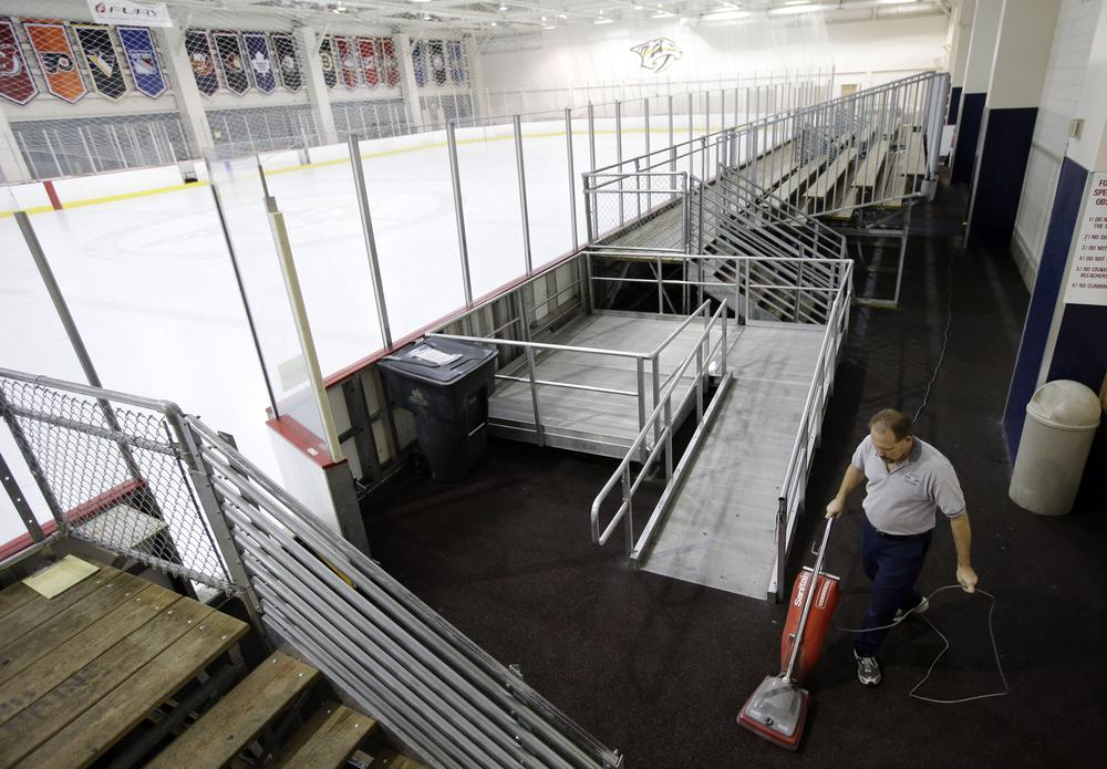 A worker cleans around an empty Nashville Predators practice rink in Tennessee. During the NHL lockout, players have had to find other places to practice. (Mark Humphrey/AP)