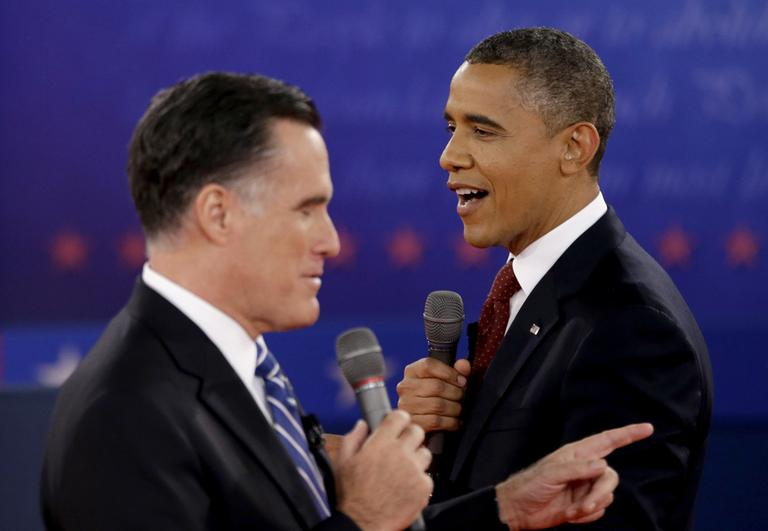 In this Oct. 18, 2012 file photo, President Barack Obama, right, and Republican presidential candidate, former Massachusetts Gov. Mitt Romney exchange views during the second presidential debate at Hofstra University in Hempstead, N.Y. (AP)