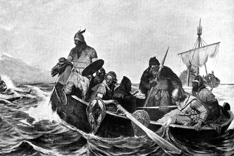 A black-and-white reproduction of a painting showing Norsemen in a ship. The list of illustrations on page vii gives this one the title Norsemen Landing in Iceland'. (Wikicommons)