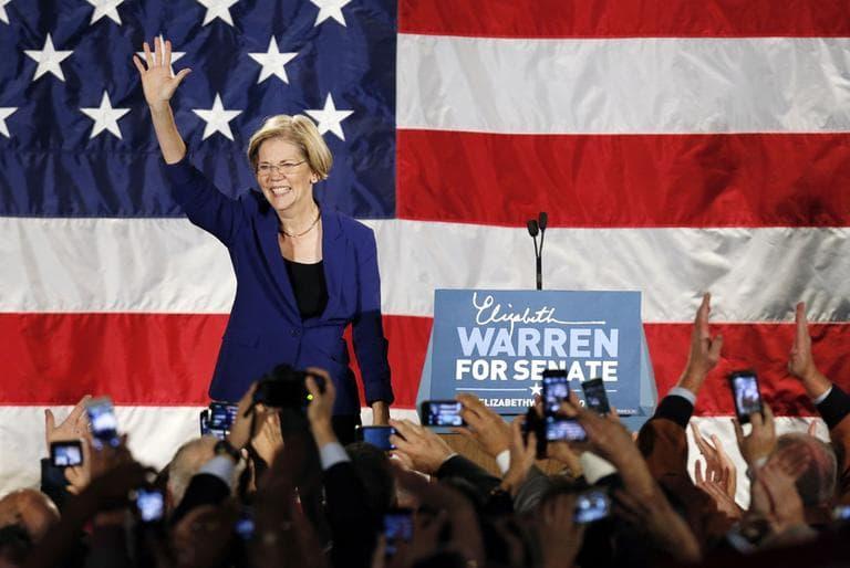 Elizabeth Warren waves to the crowd before giving her victory speech after defeating incumbent GOP Sen. Scott Brown in the Massachusetts Senate race (Michael Dwyer/AP)