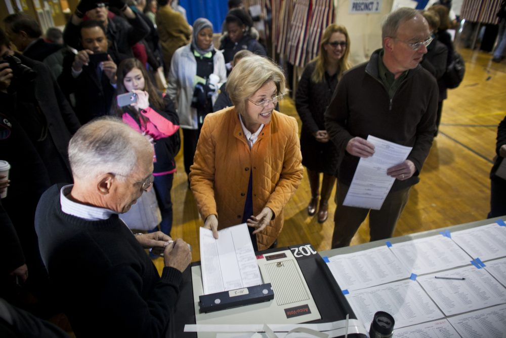 Then-U.S. Senate candidate Elizabeth Warren and her husband Bruce Mann vote at a school in Cambridge on Election Day in 2012. A new study pegs Cambridge as the most liberal mid-size municipality in Massachusetts. (Dominick Reuter/WBUR)