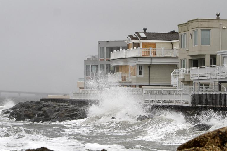 Waves crash onto the sea wall protecting homes in Longport, N.J., Sunday, Oct. 28, 2012, as Hurricane Sandy approaches the area. (AP)
