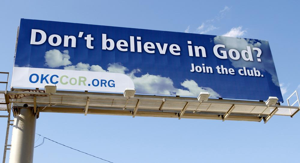 "In this Sept. 9, 2010 photo, a billboard erected by atheists in Oklahoma City reads "" Don't believe in God? Join the club."" (Sue Ogrocki/AP)"