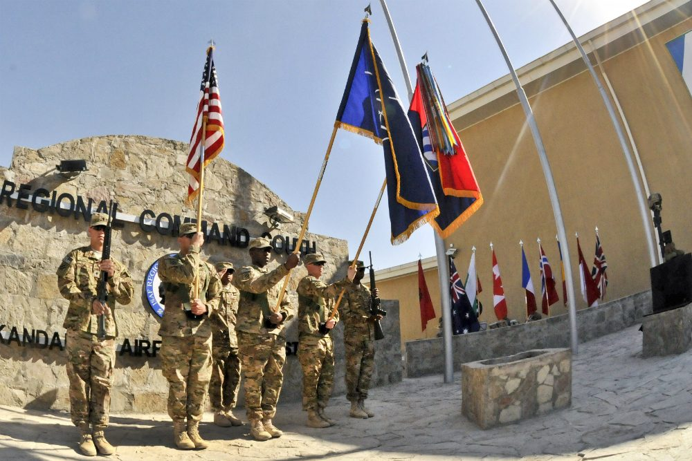 Color guard members present the colors for Regional Command South during a Veterans Day ceremony at the command's headquarters on Kandahar Airfield, Afghanistan, Nov. 11, 2012. (Staff Sgt. Brendan Mackie/U.S. Army)