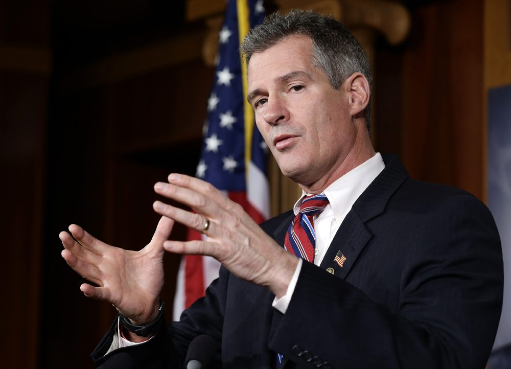 Then-U.S. Sen. Scott Brown speaks in November 2012, a week after he was unseated by Elizabeth Warren. Brown is now weighing another Senate bid -- in New Hampshire. (Alex Brandon/AP)