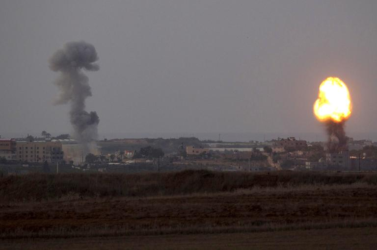 Explosion and smoke rise following an Israeli strike in the Gaza Strip, seen from the Israel Gaza Border, southern Israel, Friday, Nov. 16, 2012. (AP)
