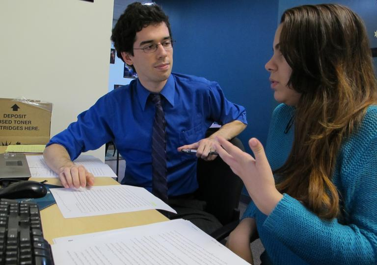 Emily Soto works on her college applications with Joe Maurer, a counselor at Bottom Line, a nonprofit that helps disadvantaged students get into college. (Monica Brady-Myerov/WBUR)