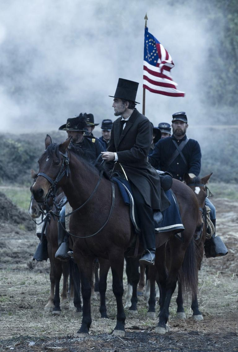"""Daniel Day-Lewis, center, as President Abraham Lincoln, in a scene from director Steven Spielberg's drama """"Lincoln,"""" which opened nationwide on Nov. 16, 2012. (DreamWorks, Twentieth Century Fox, David James/AP)"""