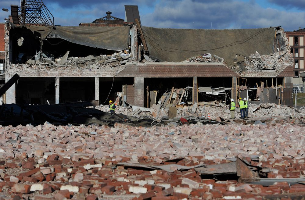 Inspectors assess damage on Saturday around the area of a gas explosion that leveled a strip club in Springfield, Mass. on Friday evening. (Jessica Hill/AP)