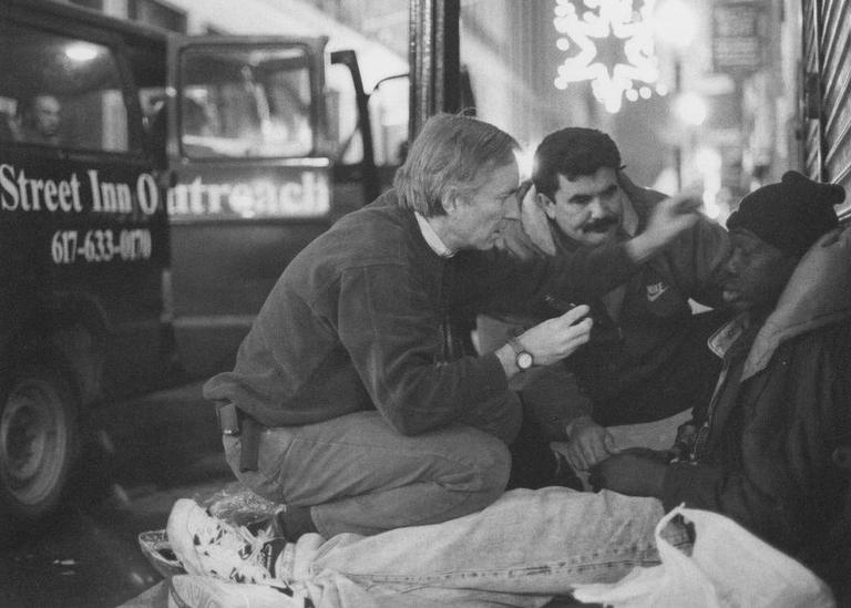Outside the Pine Street Inn van, Dr. Jim O'Connell treats a patient. (Courtesy)