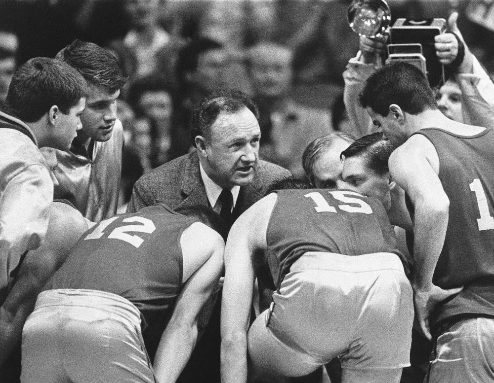 Actor Gene Hackman leads a team huddle during the filming of the 1986 movie 'Hoosiers' at Butler University's Hinkle Fieldhouse. Screenwriter Angelo Pizzo and director David Anspaugh will be inducted into the Indiana Basketball Hall of Fame in 2013. (Tom Strickland/AP)