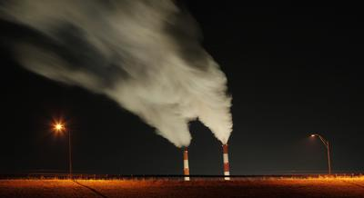 In this Jan. 19, 2012 file photo, smoke rises in this time exposure image from the stacks of the La Cygne Generating Station coal-fired power plant in La Cygne, Kan. Federal records show that this year the nation's weather has been hotter and more extreme than ever. (Charlie Riedel/AP, file)