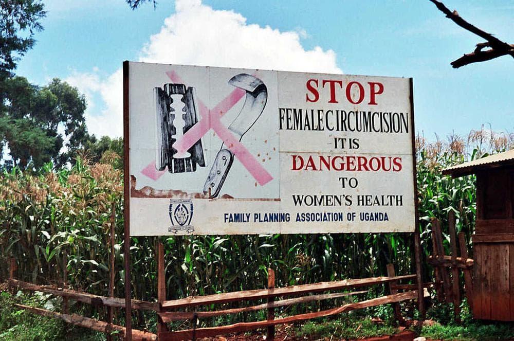 A roadside sign in Uganda (Amnon Shavit/Wikimedia Commons)