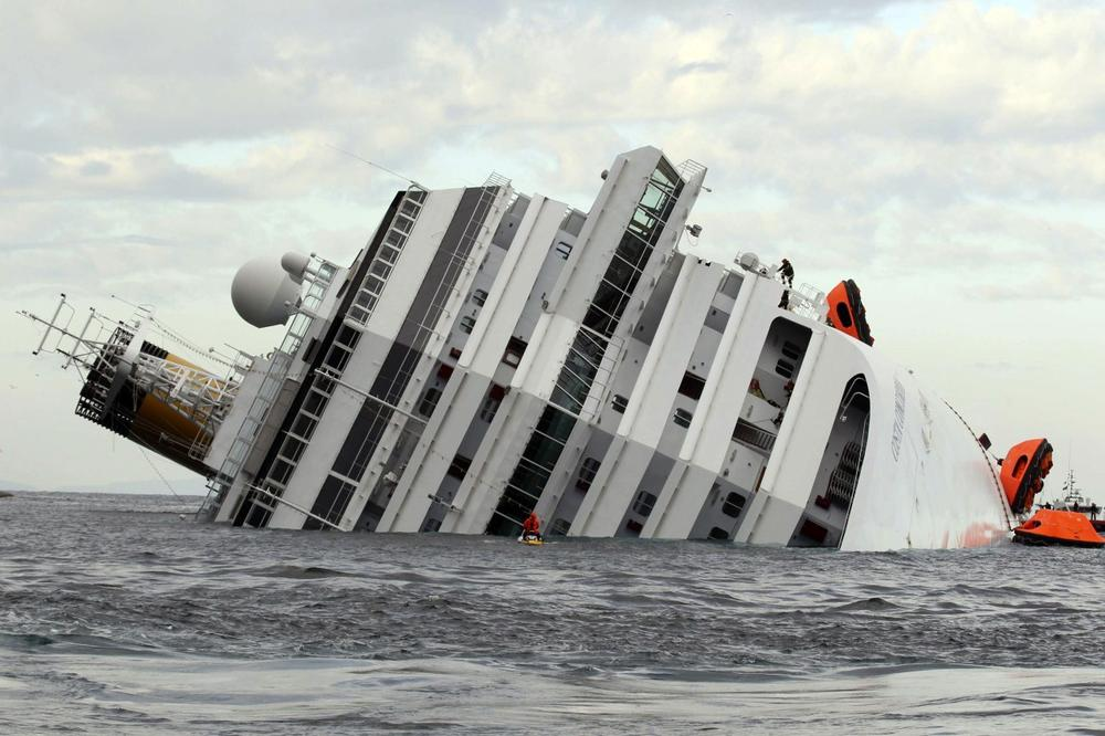 The luxury cruise ship CostaConcordia lies on its side after it ran aground off the tiny Tuscan island of Giglio, Italy, Sunday, Jan. 15, 2012. The The Costa Concordia hit a rock while passing too close to the island on Jan. 13, 2012. 32 people died in the tragedy. (AP Photo/Andrea Sinibaldi, Lapresse)