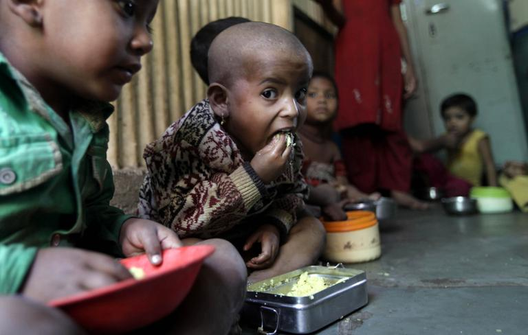 Malnourished children eat a meal at the Apanalay center, an organization working with malnourished children, in Mumbai, India, in January, 2012. (Rajanish Kakade/AP)