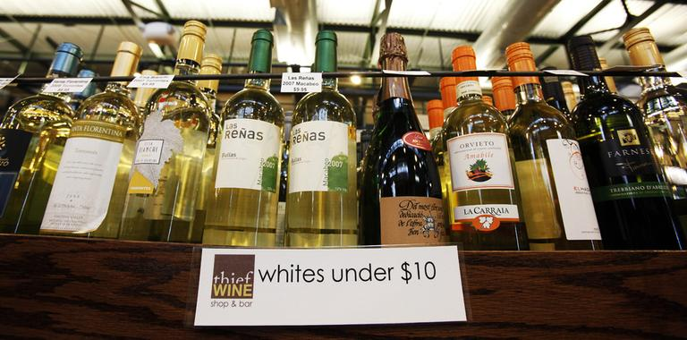 In this 2009 photo, white wines priced under $10 are displayed at Thief Wine in Milwaukee. (Morry Gash/AP)