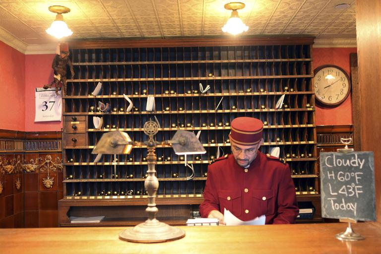 A man works at the front desk of a hotel in New York City's Greenwich Village in March 2009. (Mary Altaffer/AP)
