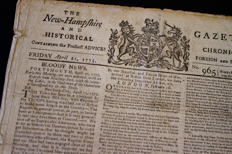 "Todd Andrlik's April 21, 1775, copy of The New Hampshire Gazette shows the headline ""Bloody News."" (Jesse Costa/WBUR)"