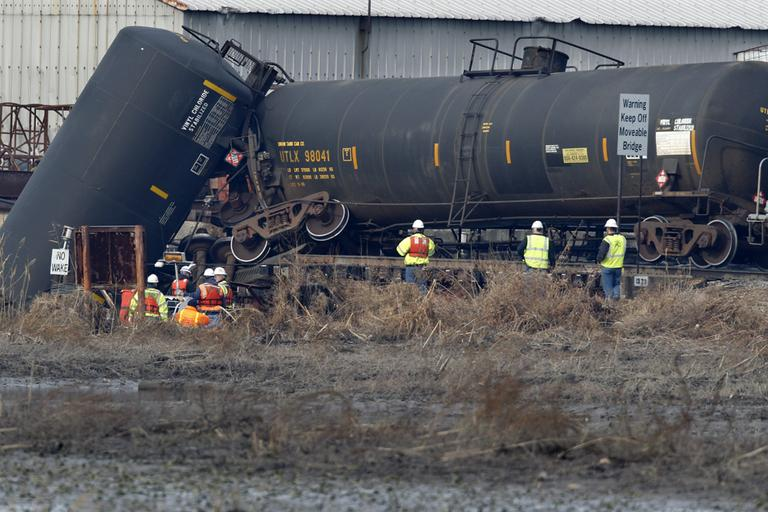 Officials examine the area around a derailed freight train tank car in Paulsboro, N.J. on Nov. 30, 2012. (Mel Evans/AP)