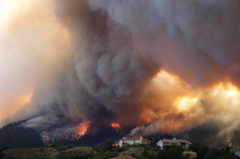 Fire from the Waldo Canyon wildfire burns as it moved into subdivisions and destroyed homes in Colorado Springs, Colo. June 26, 2012. (AP Photo/Gaylon Wampler, File)