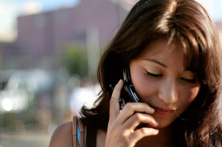 A woman speaks on her cellphone. (mark sebastian/Flickr)