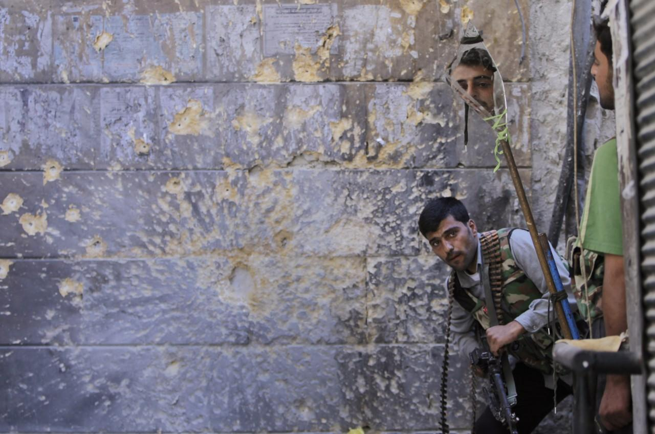 Photos Memorable Images From 2012 Wbur News 1209 Kemeja Army Black A Free Syrian Soldier Right Looks Through Mirror Which Helps Him See