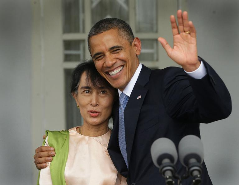U.S. President Barack Obama, right, waves as he embraces Myanmar democracy activist Aung San Suu Kyi after addressing members of the media at Suu Kyi's residence in Yangon, Myanmar, Nov. 19, 2012. Obama became the first U.S. president to visit the Asian nation also known as Burma. (AP Photo/Pablo Martinez Monsivais)