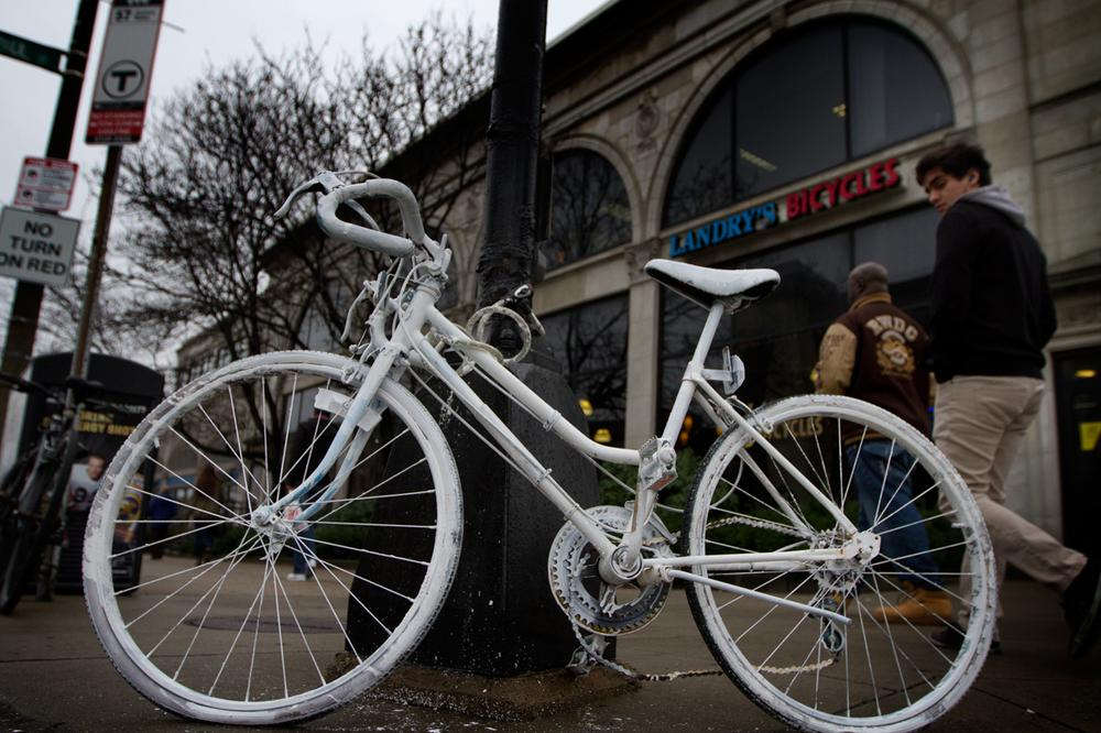"A memorial ""ghost bike"" is seen on the corner of Commonwealth Avenue and St. Paul Street, where cyclist Christopher Weigl, 23, died on Thursday. (Jesse Costa/WBUR)"