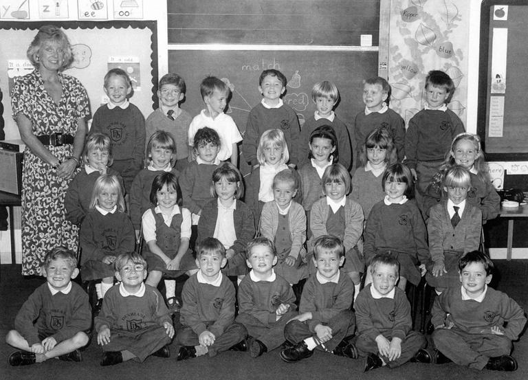 This undated file photo shows the class of Dunblane Primary School, Scotland, and their teacher, Gwen Mayor. On March 13, 1996, 16 children and Mayor were killed when gunman Thomas Hamilton entered the school and opened fire with four handguns before finally killing himself. (AP)