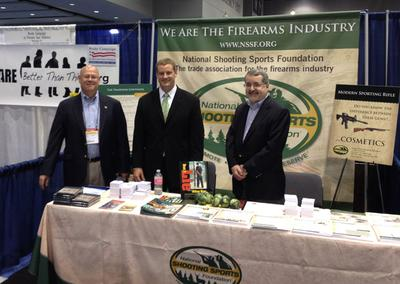 Representatives of the Newtown-based National Shooting Sports Foundation stand in their booth at the National Conference of State Legislatures in Chicago in August. From left, Lawrence G. Keane, NSSF senior vice president and general counsel; Jake McGuigan, NSSF director of government relations - state affairs; and Mike Bazinet, NSSF director of public affairs. (www.nssf.org)