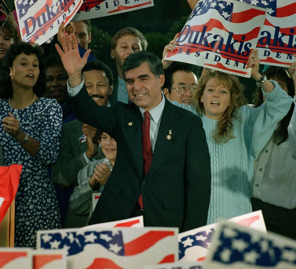 During his campaign for president, Gov. Dukakis waves to supporters at a rally in Los Angeles, Ca., Oct. 15, 1988. (Doug Mills/AP)