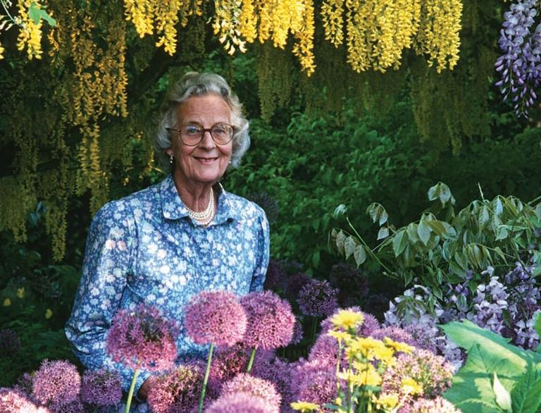 English garden designer Rosemary Verey is pictured in the Laburnum Walk at her house, Barnsley House. (Andrew Lawson)