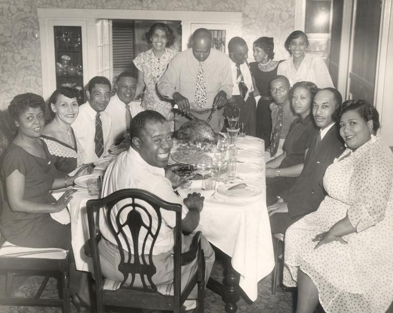 A holiday dinner with Louis Armstrong and family, circa 1940s. (Louis Armstrong House)