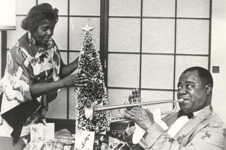 Louis and Lucille Armstrong with a Christmas tree. (Louis Armstrong House)