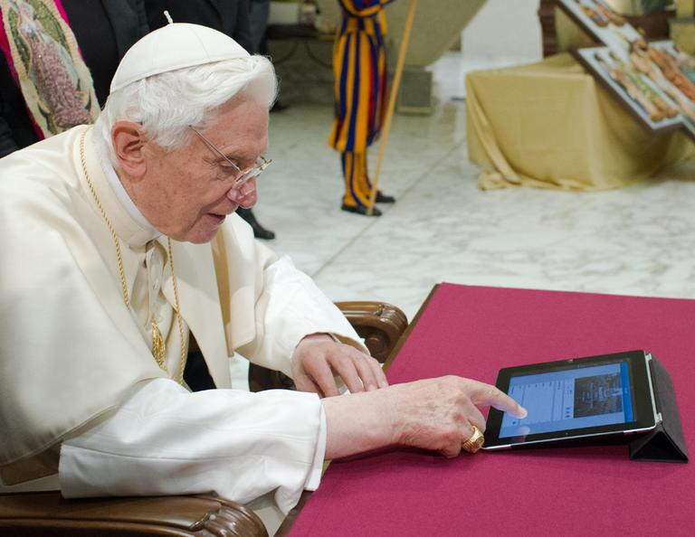 In this December 2012 photo provided by the Vatican newspaper L'Osservatore Romano, Pope Benedict XVI pushes a button on a tablet at the Vatican. (Osservatore Romano/AP)