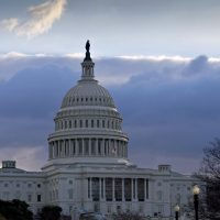 """The U.S. Capitol is seen as Congress convenes to negotiate a legislative path to avoid the so-called """"fiscal cliff"""" of automatic tax increases and deep spending cuts that could kick in Jan. 1., 2013.  (AP/J. Scott Applewhite)"""