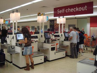 Theft is common at self-checkout machines, because the customer is also the cashier. (Flickr/pinadd)